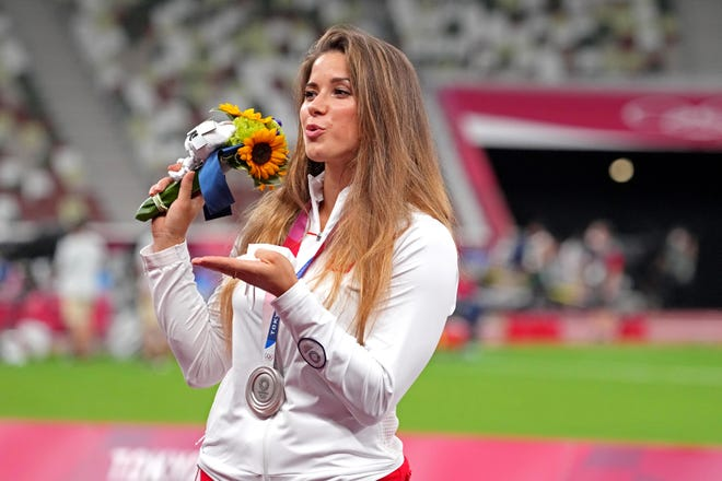 Polish javelin thrower auctions Tokyo Olympics silver medal to help infant get heart surgery